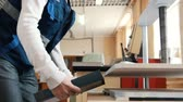paper : Printing process - worker inserts paper sheets in industrial press