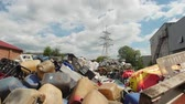 galão : Large piles of plastic containers lie on the territory of the plant