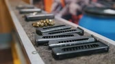atirador : Pistol clips with bullets in shooting gallery Stock Footage