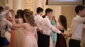 finomság : KAZAN, RUSSIA - MARCH 30, 2018: Young couples whirling in the beautiful dance at party in city hall