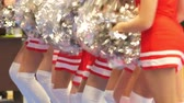 entusiasta : Girls cheerleaders in a red dresses dancing with pompoms