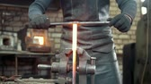 hammers : Muscular blacksmith in forge hammering steel products