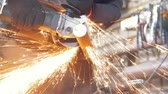ferreiro : Blacksmith worker in forg making detail with circular saw Stock Footage