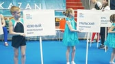 desigual : KAZAN, RUSSIA - APRIL 18, 2018: The championship of sports gymnastics - children with tablets at the gymnastics championship