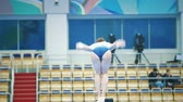 performs : KAZAN, RUSSIA - APRIL 18, 2018: All-Russian gymnastics championship - female athlete gymnast performing a back trick at the balance beam