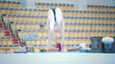 participante : KAZAN, RUSSIA - APRIL 19, 2018: All-Russian gymnastics championship -Flexible woman gymnast performing at the court