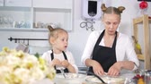 twarożek : Mom with her daughter sculpts cottage cheese pancakes