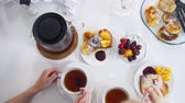 twarożek : Mother with daughter drink tea with cherry and pancakes Wideo