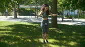 bandaj : Young slender woman jumping with a rope, boxing workout outdoors at sunny day