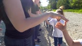 trest : Teenagers and children teams greeting each other with shake hands at summer sunny day