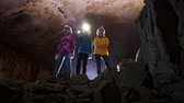teenagers : Children visiting the minerals in the cave