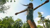 backyard : Happy little girl with long hair having fun in summer park