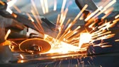 a construção do corpo : Sparks from welding car parts in a car repair shop