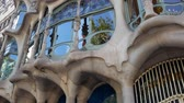 oval : Barcelona, Spain - September 2018: Casa Batllo facade, many unidentified tourists in front of famous building. Art Nouveau architecture by Antoni Gaudi, recognizable landmark house
