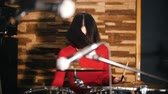 rehearsal : Repetition. Girl fervently plays the drums