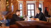pivo : Two guys sitting at a table in a restaurant Dostupné videozáznamy
