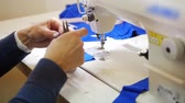 costuming : Woman works with cloth on Sewing Machine