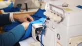 handy : Making clothes. Woman works with cloth on Sewing Machine. Focus on cloth Stock Footage