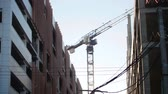 realtor : Industry construction and development. Concrete walls. Working construction crane Stock Footage