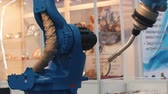 distribution : Blue industrial machine doing its work. A Lathe Stock Footage