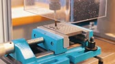 mekanik : Industrial production. CNC machine carves a lot of holes Stok Video