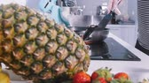 piña : A woman shifts ready pancakes in the background Archivo de Video