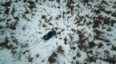 helicopter view : A winter forest. Two people riding the snowmobile. Helicopter shooting Stock Footage