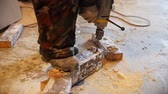 drilling site : Industrial. Construction site. The man worker drilling the snowy brick. Slow motion Stock Footage