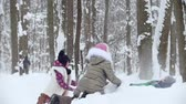 wintertime : Winter forest. Two little girls Throw snow on their little brother