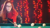 biliardo : Billiard club. Concentrated ginger woman aiming and hitting the ball Filmati Stock
