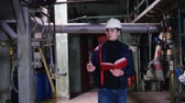 inspector : A man engineer walking in manufacturing plant Stock Footage