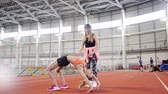 соответствовать : Two athletic women doing gymnastic sport exercises. A woman bending over