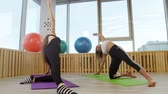 posição : Young women doing yoga in the gym. Doing breathing exercises