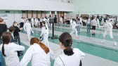 防衛 : 27 MARCH 2019. KAZAN, RUSSIA: A big tournament in the hall with many people. Teenage girls fencers are getting ready for the round