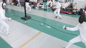 фехтование : 27 MARCH 2019. KAZAN, RUSSIA: Teenagers fencers in protective clothes fighting on a tournament