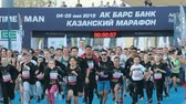 sportos : 05-05-2019 RUSSIA, KAZAN: A running marathon starting. Different people running