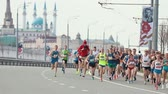 sportos : 05-05-2019 RUSSIA, KAZAN: A running marathon. Different people running on the side of the road Stock mozgókép