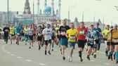 sportos : 05-05-2019 RUSSIA, KAZAN: A running marathon. People running on the side of the road on a background of Kazan Kremlin
