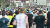 following : 05-05-2019 RUSSIA, KAZAN: A running marathon. A big crowd of people running on the road. Back view