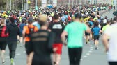 sportos : 05-05-2019 RUSSIA, KAZAN: A running marathon. A crowd of people running on the road. Back view Stock mozgókép