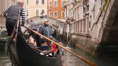 canoe : 29-04-2019 ITALY, VENICE: Excursions by the water channels on canoes. Crowds of people