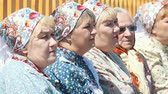 broderie : RUSSIA, Nikolskoe village, Republic of Tatarstan 25-05-2019: A group of old women sitting on the bench and watching the performance