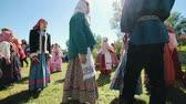 broderie : RUSSIA, Nikolskoe village, Republic of Tatarstan 25-05-2019: People in a village walking in a circle by a music. Playing traditional game
