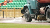 söprés : KAZAN, RUSSIA 26-07-2019: A big cleaning machine washes the running track with water stream in the stadium