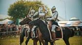 conquering : BULGAR, RUSSIA 11-08-2019: Knights having a battle on wooden swords on the field Stock Footage