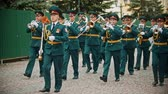saksofon : RUSSIA, KAZAN 09-08-2019: A wind instrument parade - a man holding a plate that says military orchestra of Saratov