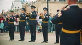 festa della musica : RUSSIA, KAZAN 09-08-2019: A wind instrument military parade - soldiery taking trumpet and start playing