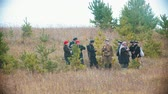 commander : RUSSIA, REPUBLIC OF TATARSTAN 30-09-2019: A reconstruction of military operations in Russia in 1917 - women and men in military clothes standing in the field