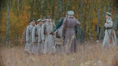 commander : RUSSIA, REPUBLIC OF TATARSTAN 30-09-2019: A reconstruction of military operations in Russia in 1917 - Soldiers standing in the row and listening to their commander - salute gesture