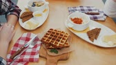 trinken : A couple having lunch - waffles and other food on the table Videos